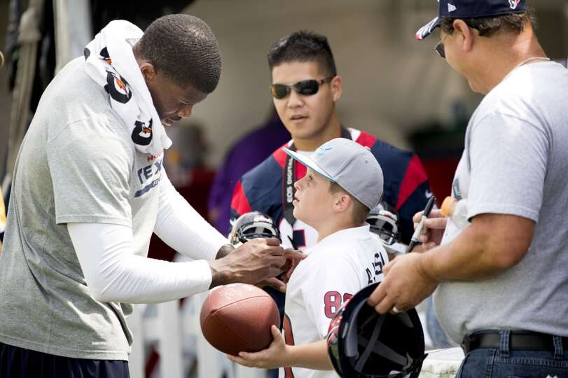 Day 4: July 29   Texans wide receiver Andre Johnson signs autograph
