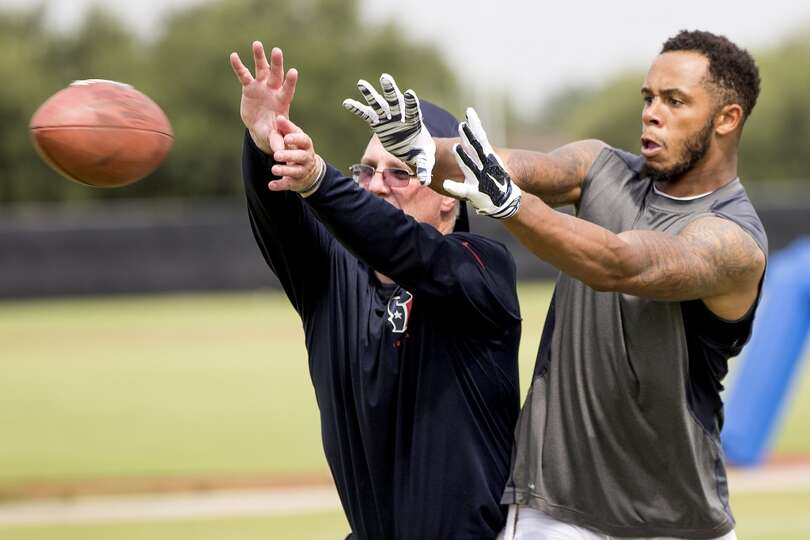 Day 4: July 29   Texans wide receiver DeVier Posey, right, reaches