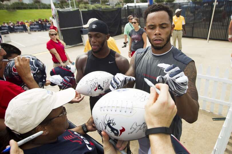 Day 4: July 29   Texans wide receivers EZ Nwachukwu, left, and DeVi
