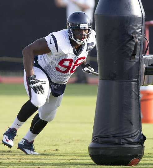 Day 4: July 29   Texans defensive end Tim Jamison gets ready to hit