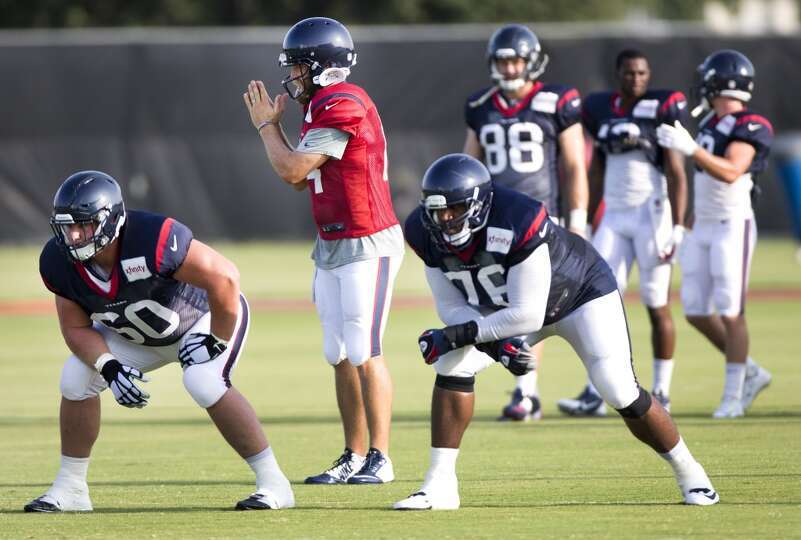 Day 4: July 29   Texans quarterback Ryan Fitzpatrick (14) signals a