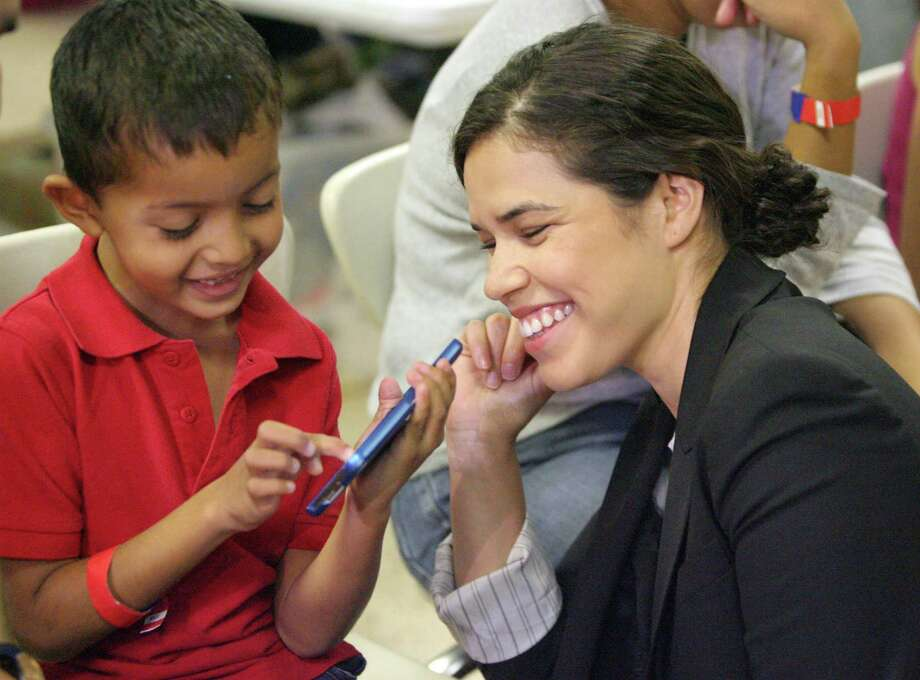 MCALLEN,TX-July 28,2014- Actress America Ferrera plays  with a Central 