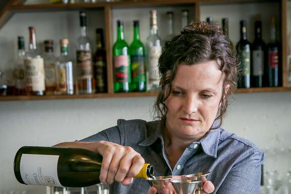 Bartender Jennifer Colliau makes the J.P.A. Martini at Interval in San Francisco, Calif., on Monday, July 28th, 2014.