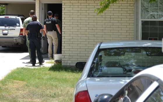 Officers prepare to make an arrest of a suspect in Seguin gang sweep. Photo: Seguin PD/Courtesy