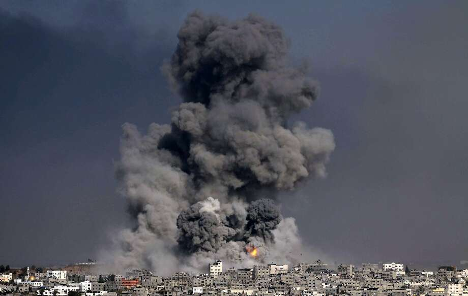 Heavy smoke billows after an Israeli air strike in Gaza City in the single deadliest day of the conflict. Photo: Ashraf Amra, AFP/Getty Images