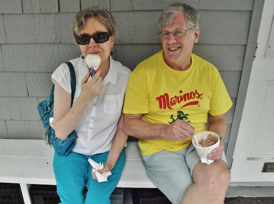 "These loyal customers travel to Dr. Mike's from Stamford every summer because ""it just wouldn't be summer without Dr. Mike's."" On July 29, 2014 they enjoyed chocolate malt and peach flavored ice cream. Photo: Nuria Ryan"