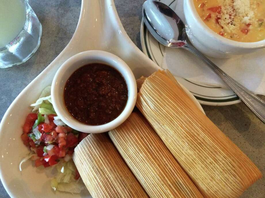 El Real's Tamale Skillet and chili con queso on the side. Shot July 2014. Photo: Syd Kearney