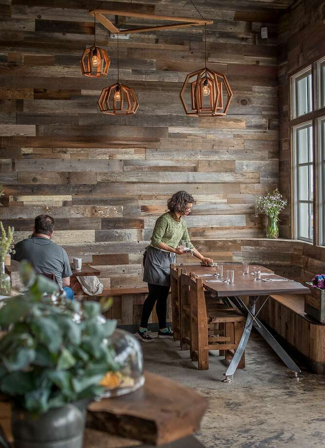 Grant K. Gibson says he loves the rustic feel that the plank walls create in the dining room of the restaurant Outerlands in San Francisco. Photo: John Storey, Special To The Chronicle