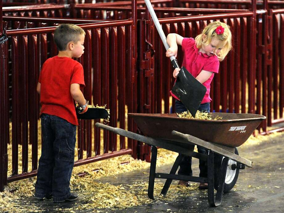 It's important for kids to grow up in a stable environment: Nate Fetzer and Casey Clark muck the pens during the 
