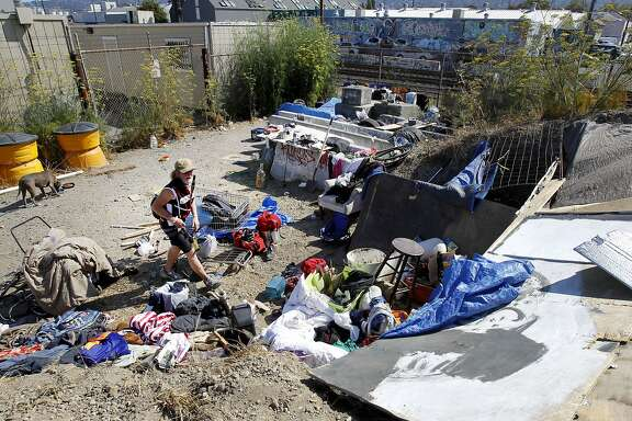 At the rear of the vacant lot off Second Street, several homeless live near the train tracks Tuesday July 29, 2014. A homeless community that began in Albany, then moved to the Gilman Street freeway underpass in Berkeley, Calif. has scattered although some are now in a vacant lot off Second Street.