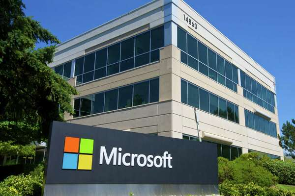 REDMOND, WASHINGTON - JULY 17: A building on the Microsoft Headquarters campus is pictured July 17, 2014 in Redmond, Washington. Microsoft CEO Satya Nadella announced, July 17, that Microsoft will cut 18,000 jobs, the largest layoff in the company's history.