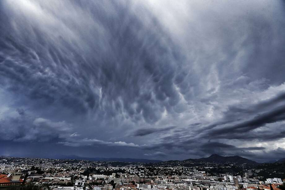 A storm approaches the French Riviera city of Nice. Photo: Valery Hache, AFP/Getty Images