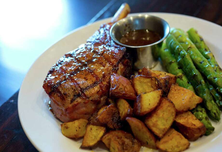 Grilled pork chops prepared by The Republic Grille at 4775 W Panther Creek Dr #490, The Woodlands, TX. (Billy Smith II / Houston Chronicle) Photo: Billy Smith II, Staff / © 2014 Houston Chronicle