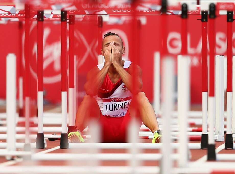 GLASGOW, SCOTLAND - JULY 29:  Andy Turner of England sits on the track after failing to finish in  Men's 110 metres hurdles Round 1 at Hampden Park during day six of the Glasgow 2014 Commonwealth Games on July 29, 2014 in Glasgow, United Kingdom.  (Photo by Clive Rose/Getty Images) *** BESTPIX *** Photo: Clive Rose, Getty Images