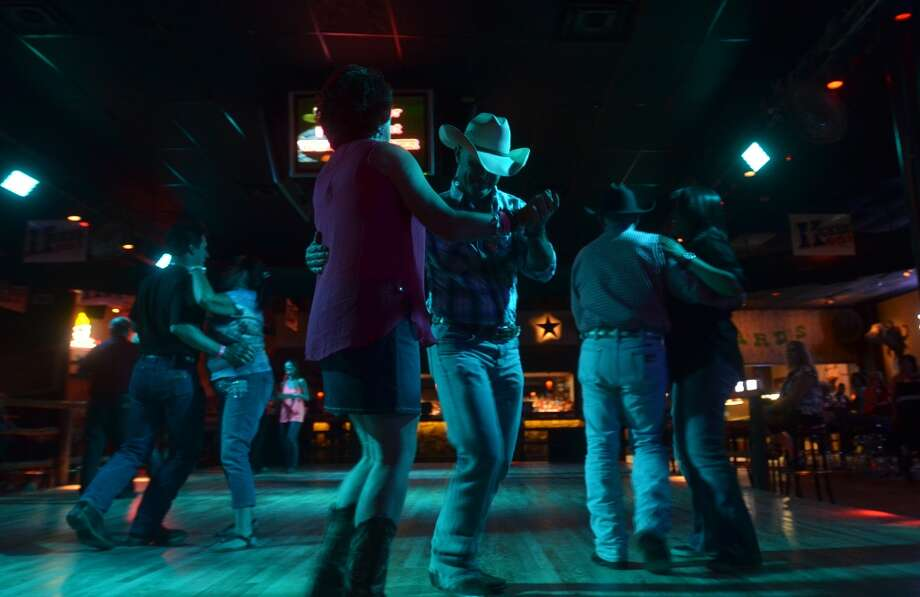 If you're the boot-scootin' type, Honky Tonk Wednesdays at Whiskey River are right up your alley. Photo: Cat5