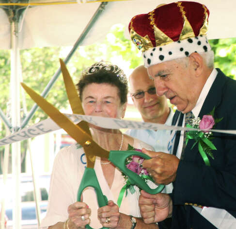 King and Queen Roland and Mary Miller handle the ribbon-cutting with aplomg as state Sen. Clark Chapin (R-30th) looks on during the opening ceremony for the Greater New Milford Chamber of Commerce's 47th annual Village Fair Days for July 25-26, 2014 on the Village Green and environs. Photo: Walter Kidd / The News-Times Freelance