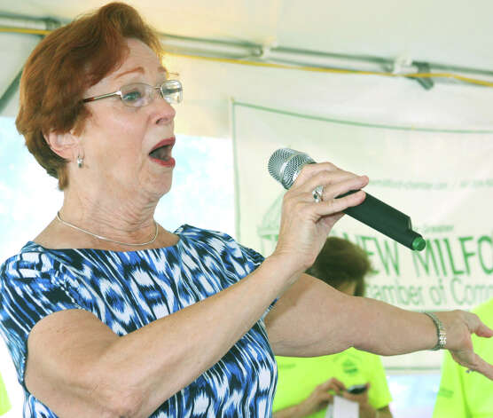 "New Milford resident Linda Parker performs ""God, Bless America,"" during the opening ceremony for the Greater New Milford Chamber of Commerce's 47th annual Village Fair Days for July 25-26, 2014 on the Village Green and environs. Photo: Walter Kidd / The News-Times Freelance"