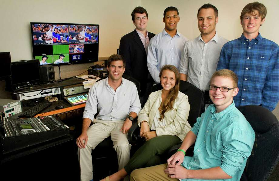 ONE World Sports interns, clockwise from top left, Timothy McErlean, Jourdan Henry, Giuliano Torelli, Kevin Steinthal, Tyler Heaton, Olivia Marcus and Alex Day pose for a photo in a studio at the company's Stamford office on Tuesday, July 29, 2014. Photo: Lindsay Perry / Stamford Advocate
