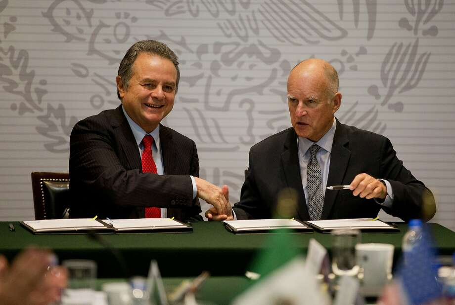 Gov. Jerry Brown (right) and Mexico's energy secretary, Pedro Joaquin Coldwell, agree on a pact. Photo: Rebecca Blackwell, Associated Press