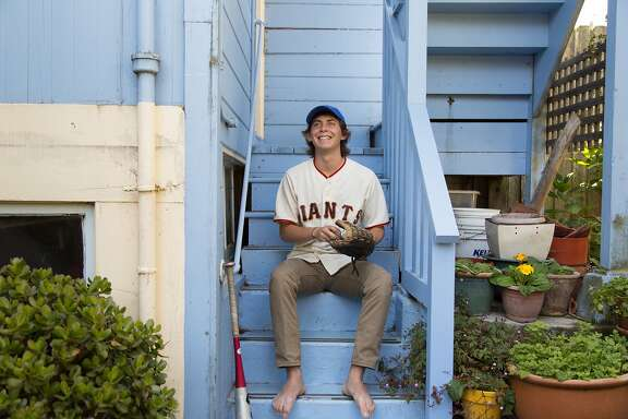 "Mica Schneider at home in San Francisco, Calif., Friday July 26, 2014. Mica is the subject of a documentary film called ""Havana Curveball"" about a teenage service project he did collecting and delivering baseball equipment to poor kinds in Cuba. The film, made by his parents Ken Schneider and Marcia Jarmel, will screen at the SF Jewish Film Festival on July 31."