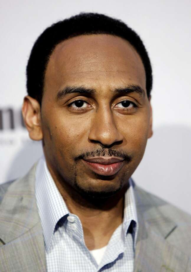 FILE - In this Saturday, Dec. 12, 2009 file photo, Stephen A. Smith arrives at Spike TV's Video Game Awards in Los Angeles. ESPN says it has suspended sportscaster Stephen A. Smith, Tuesday, July 29, 2014 for a week because of comments about domestic abuse suggesting women should make sure they don't provoke attacks.  (AP Photo/Matt Sayles, File) Photo: Matt Sayles, Associated Press