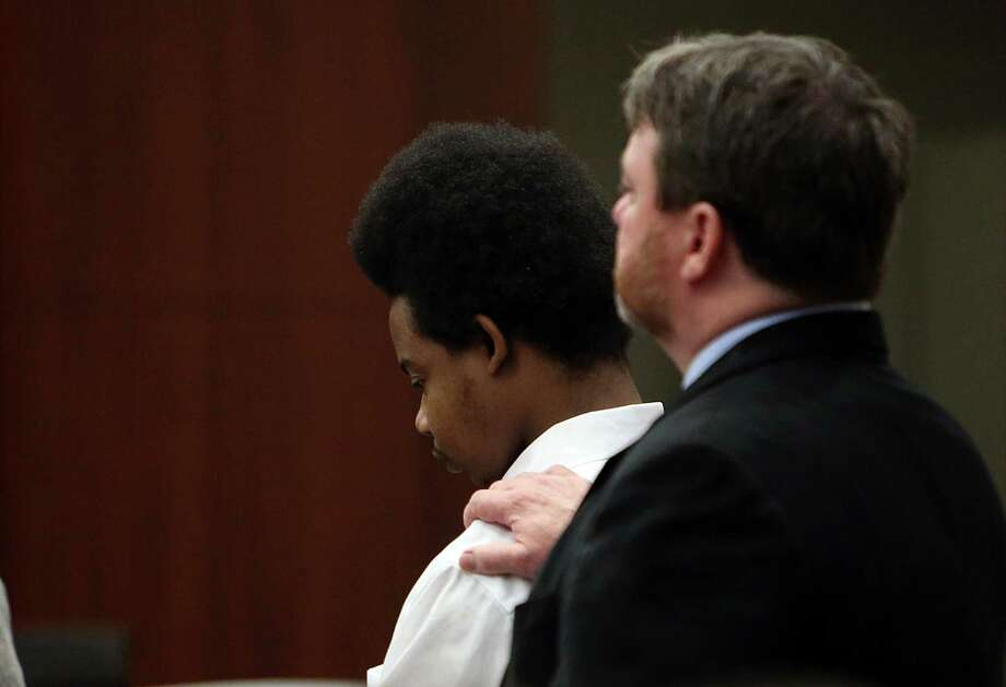 Harlem Lewis listens verdict where jurors sentence him to death at the Harris County Criminal Courthouse on Tuesday, July 29, 2014, in Houston.  Jurors deliberate for 12 hours over a 2 day span. Photo: Mayra Beltran, Houston Chronicle / © 2014 Houston Chronicle