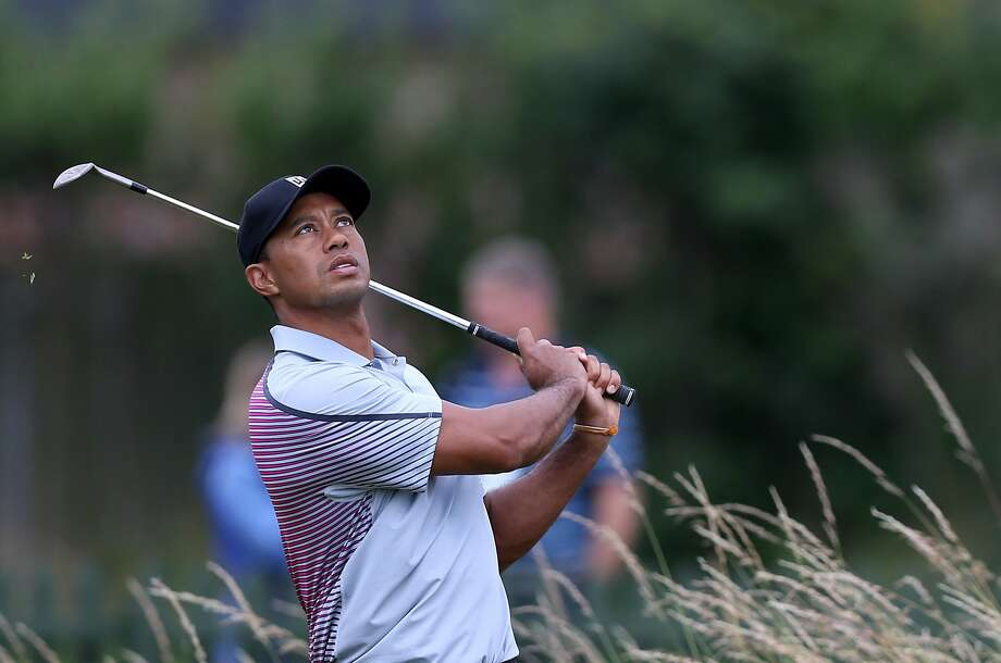 Tiger Woods has struggled this year because of back problems, but he's the defending champ at the Bridgestone Invitational, and it's at a course on which he has been highly successful. Photo: Scott Heppell, Associated Press