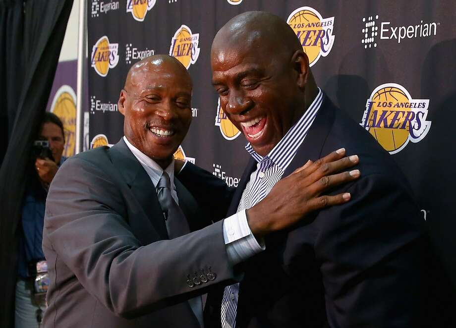 Byron Scott (left) laughs with Magic Johnson at a news conference to introduce Scott as coach. Photo: Jeff Gross, Getty Images