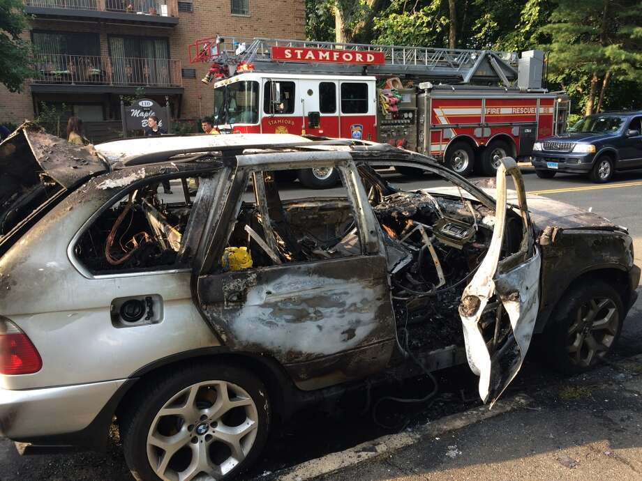 Car fire on Maple Tree Ave. in Stamford, July 29, 2014. Photo: Chris Preovolos