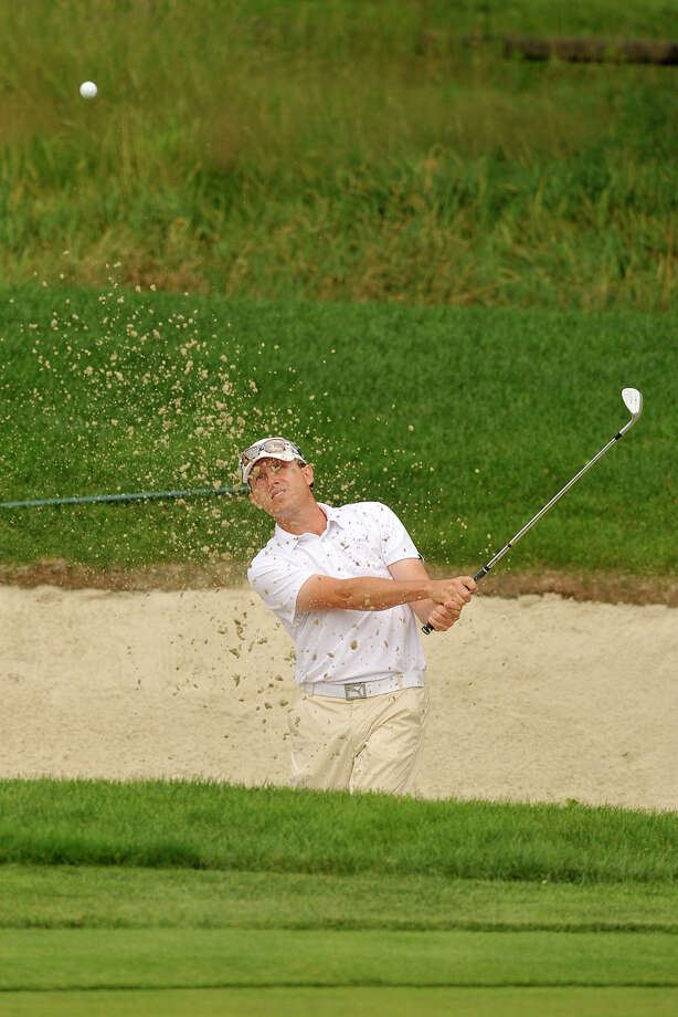 Jason Caron escapes the bunker onto the 10th green during the 80th Connecticut Open golf championship at Rolling Hills Country Club in Wilton, Conn., on Tuesday, July 29, 2014. Photo: Jason Rearick / Stamford Advocate
