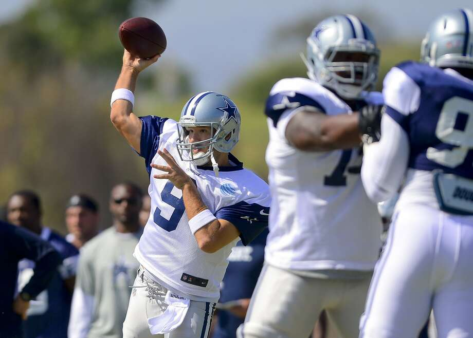The Cowboys have limited Tony Romo's throws in camp so far. He had surgery on a herniated disk in December. Photo: Gus Ruelas, Associated Press