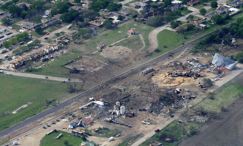 This April 18, 2013 file photo shows an aerial view of the remains of a fertilizer plant and an apartment complex to the left, destroyed by an explosion in West, Texas.  The government has failed to inspect virtually all of the chemical facilities that it considers to be at high risk for a terror attack, numbering in the thousands, and has underestimated the threat to densely populated cities, congressional investigators say.  (AP Photo/Tony Gutierrez, File) Photo: Tony Gutierrez, STF / AP