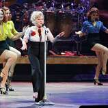 """Bette Midler started her two year residency at Caesar's Palace in 2008 with her show, """"Bette Midler: The Showgirl Must Go On."""" The show featured a 13-piece band as well as a gaggle of dancers from a dance troupe known as The Staggering Harlettes, or the """"Caesar Salad Girls"""" as they were called in the show.HBO recorded and aired the performance, which was nominated for a Primetime Emmy for """"Outstanding Variety, Music Or Comedy Special"""" in 2011.Pictured: Entertainer Bette Midler (C) sings during the 100th performance of her show, """"The Showgirl Must Go On"""" at The Colosseum at Caesars Palace June 7, 2009 in Las Vegas, Nevada."""