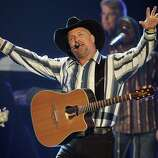 Whatever caused country singer Garth Brooks to retire in 2001 – not going to say it was the fallout from alter-ego Chris Gaines, but come on – he brushed it all aside to take up the Vegas stage.Brooks signed a five-year performing contract at the Encore Las Vegas at the Wynn Hotel and Casino on the Strip. Brooks performed on weekends for an untold sum. One of the benefits of the contract included a private jet to fly Brooks from Vegas to his Oklahoma estate whenever he felt homesick.Pictured: Music artist  Garth Brooks performs during the 43rd annual Academy of Country Music Awards at the MGM Grand Garden Arena May 18, 2008 in Las Vegas, Nevada.