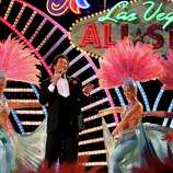 """Think you've worked at your job too long? Wayne Newton estimates he's played 30,000 shows in the city of Las Vegas alone. With that fun fact in mind, Newton's nickname, """"Mr. Las Vegas,"""" seems more a statement of fact than a gauche claim of city-wide ownership.Another fun fact: Newton would regularly fill in for Sammy Davis Jr. at the Sands when Davis would call in sick, which was reportedly – and somewhat predictably – often.Pictured: Singer Wayne Newton performs at the 2007 NBA All Star Game on February 18, 2007 at Thomas & Mack Center in Las Vegas, Nevada."""