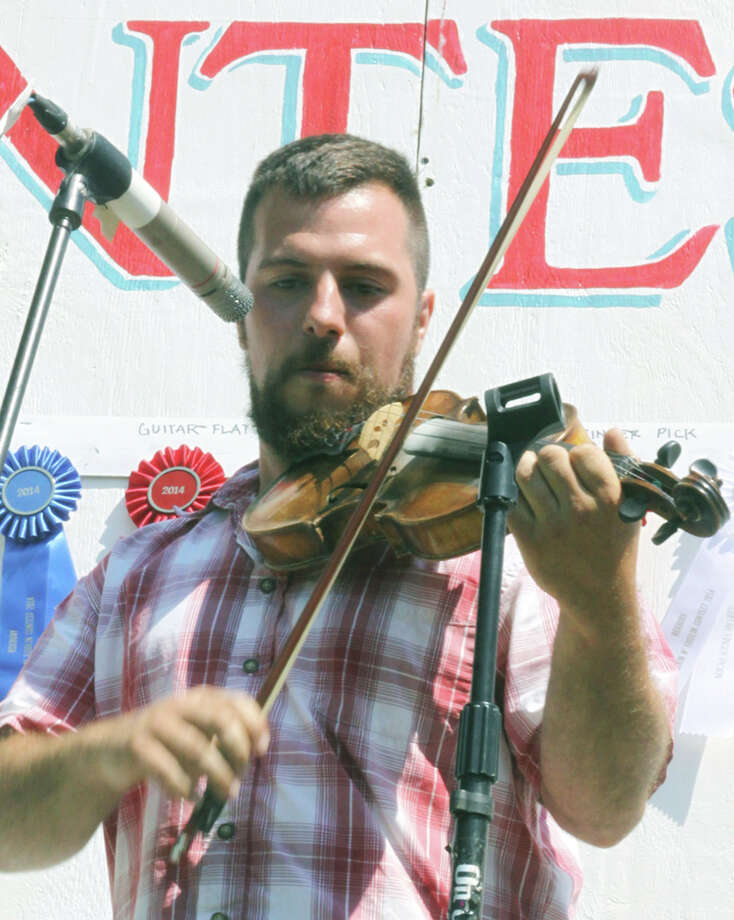 Joe Mangini of Washington performs in the Old Time category during the Roxbury Volunteer Fire Department's 41st annual Pickin' and Fiddlin' contest, July 12, 2014 at Hurlburt Community Park along West Apple Lane in Roxbury. Photo: Walter Kidd / The News-Times Freelance