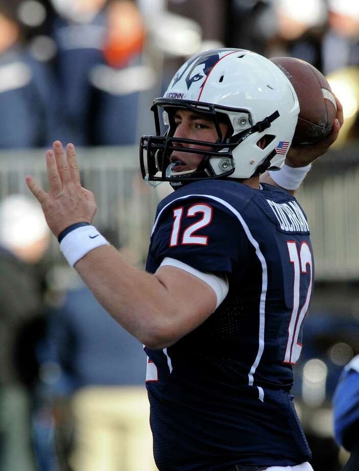 Connecticut quarterback Casey Cochran (12) during Connecticut's 45-10 victory over Memphis in an NCAA college football game, in East Hartford, Conn., on Saturday, Dec. 7, 2013. (AP Photo/Fred Beckham) Photo: Fred Beckham, Associated Press / Associated Press