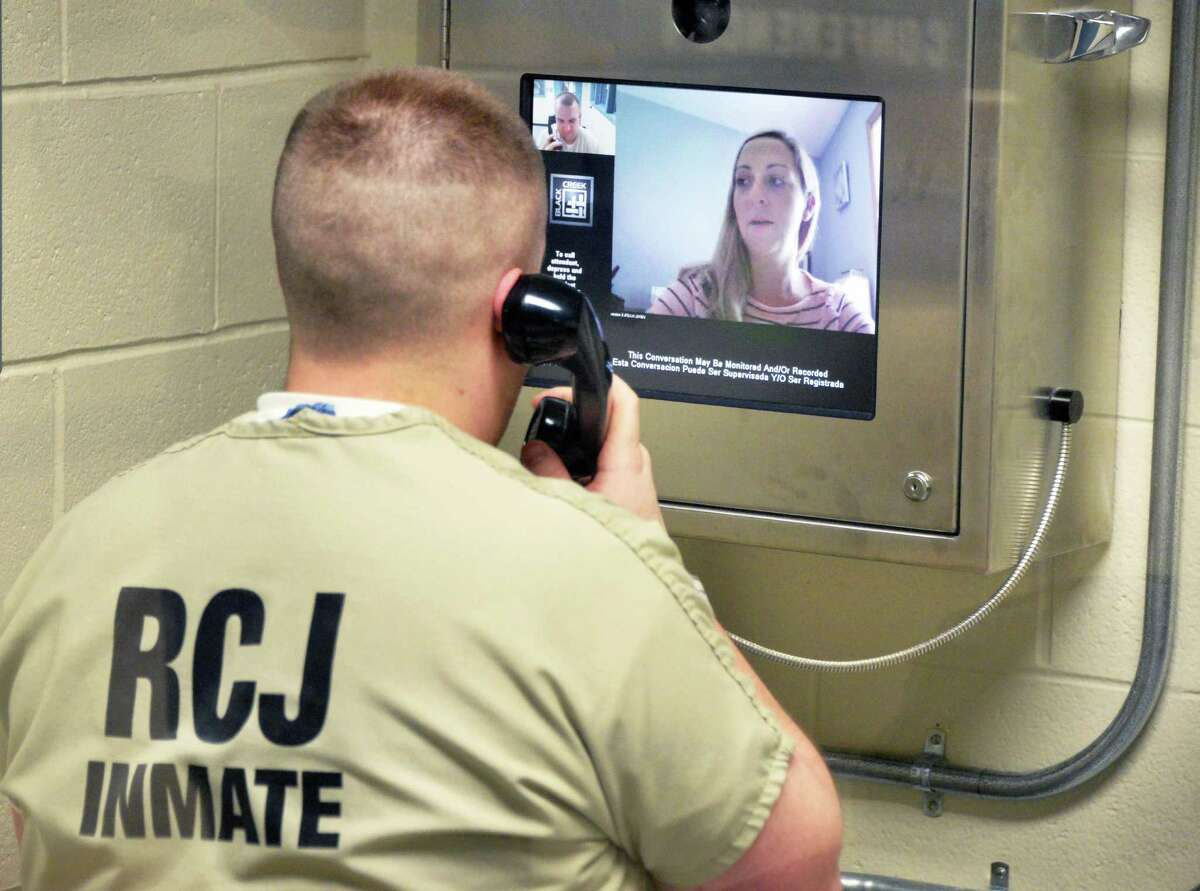 Inmate Benjamin Bornhorst uses a new remote video visitation system to speak with a family member via the internet at the Rensselaer County Jail Tuesday, July 29, 2014, in Troy, N.Y. (John Carl D'Annibale / Times Union)