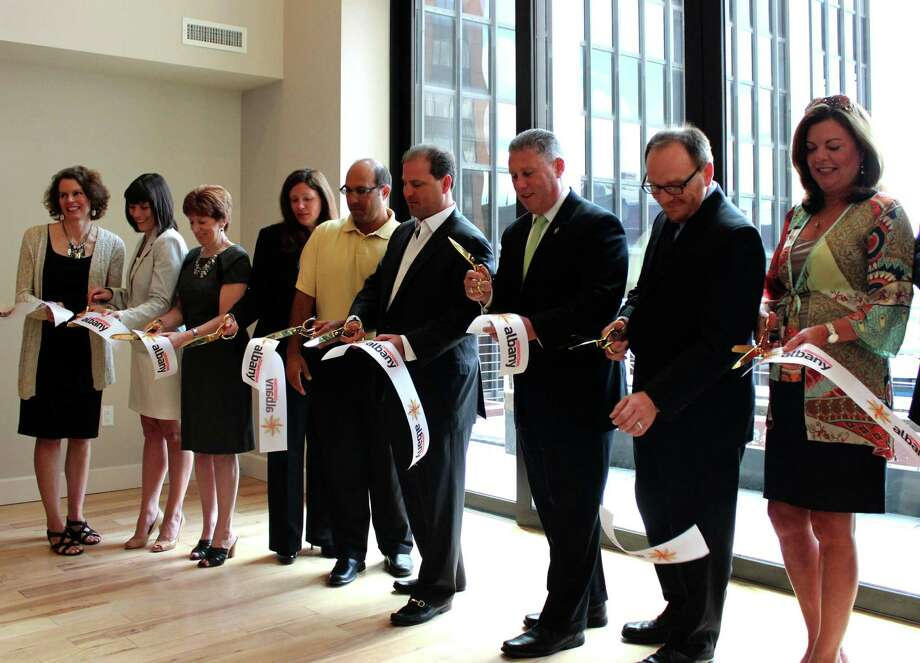Members of the downtown Albany business community cut the ribbon at the grand opening of Park Place Apartments Tuesday morning, July 29, 2014, at 60 State St. in Albany N.Y. (Selby Smith/Special to the Times Union) Photo: Selby Smith / 00027972A
