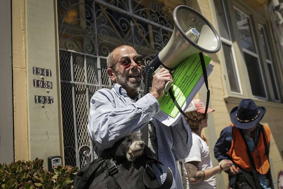 "Ted Gullicksen, executive director of the San Francisco Tenants Union during a campaign in association with the San Francisco Tenants Union where protesters posted signs on apartments along Mason St. where the previous tenants had been evicted, due to the Ellis act, and the current occupants are renting the space using VRBO on July 29th 2014. The signs posed on doors stated: "" WARNING! The Apartments in this building have been illegally converted to hotel rentals."" and advised renters to leave. Photo: Sam Wolson, Special To The Chronicle"