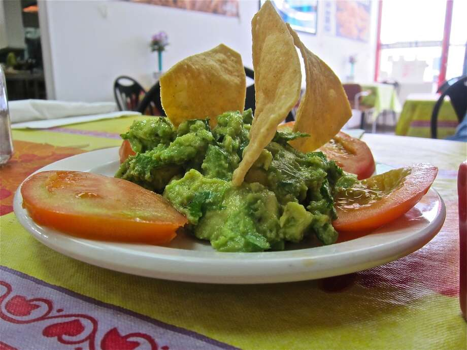Alison Cook, a restaurant critic for the Houston Chronicle, dines out a lot through the course of her job. Here we've compiled her thoughts on a few of those meals. Take this latest dish, for example. If you think a gas station can't serve up delicious eats, then think again. This guacamole at Mercedes Mexican Food in Texaco's Canal Food Stop wowed Cook.Keep clicking to take a look at other local dishes that are worth a try. Photo: Alison Cook