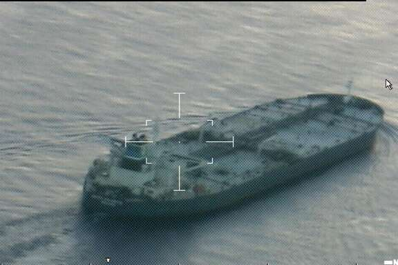 A photo taken from a U.S. Coast Guard HC-144 Ocean Sentry airplane shows the tanker United Kalavryta underway in the Gulf of Mexico on July 25, 2014, before it anchored off Galveston with a load of oil from Kurdistan, a semi-autonomous region of Iraq. The Iraqi government alleged the oil was smuggled from Iraq, and the legal dispute went to U.S. courts.