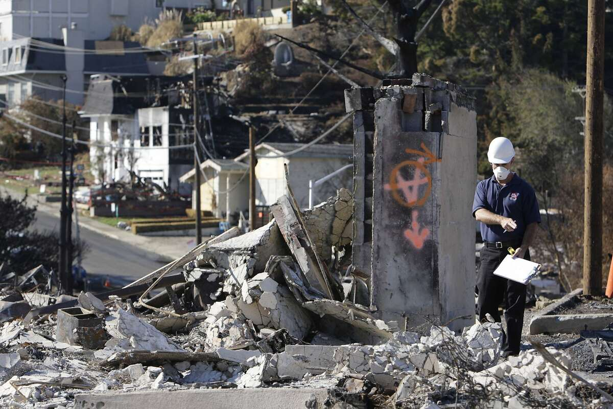 An insurance adjuster works at the scene of a destroyed home near the epicenter of the gas line explosion on Friday, September 24, 2010 in San Bruno, Calif.