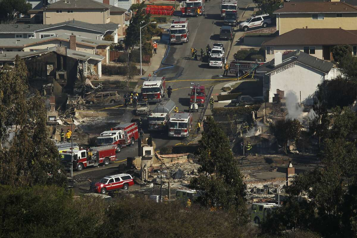 Emergency personnel are seen working next to the property of 1115 Fairmont Drive ( at left) on the site of the natural gas explosion, on Friday Sept. 10, 2010, that leveled a neighborhood the night before in San Bruno, Calif.