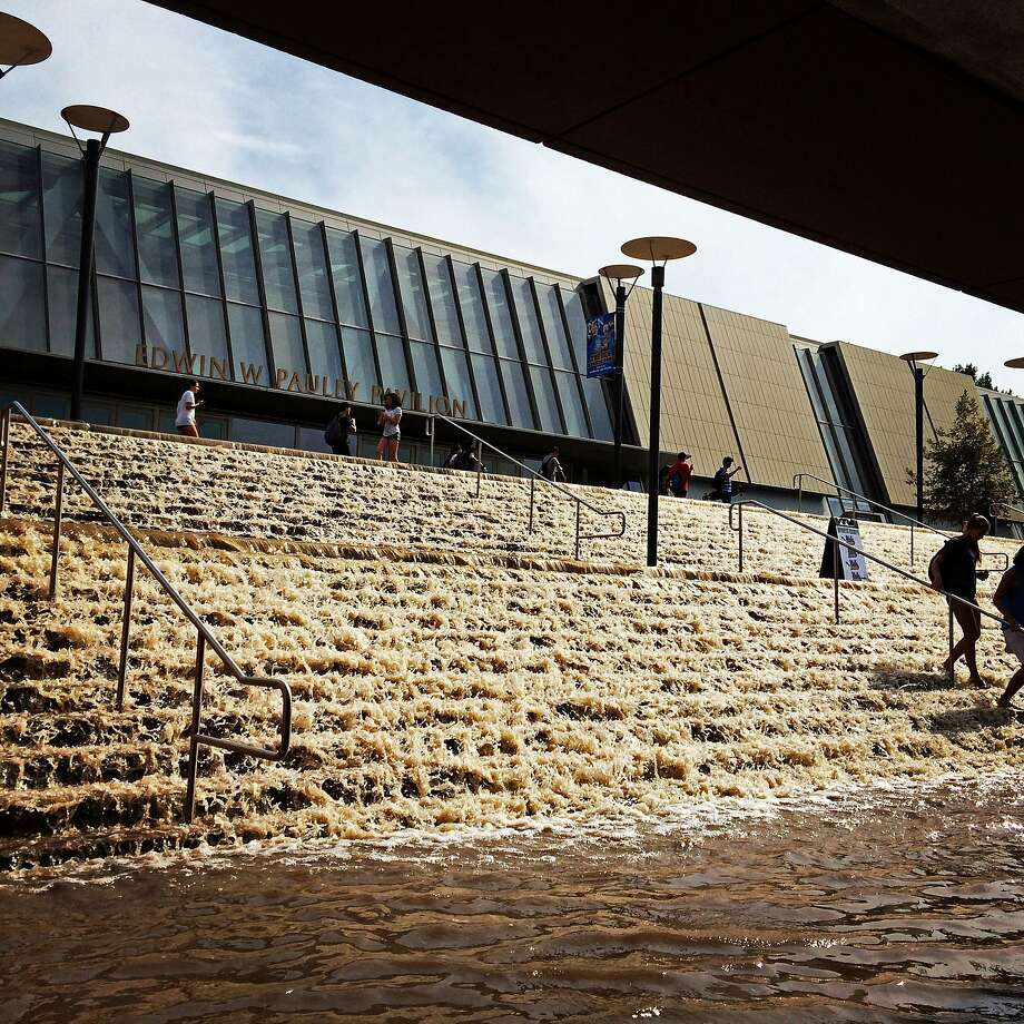 Water cascades down a stairway to a parking structure adjacent to Pauley Pavlion, home of UCLA basketball, on Tuesday. Photo: Paul Phootrakul, Associated Press