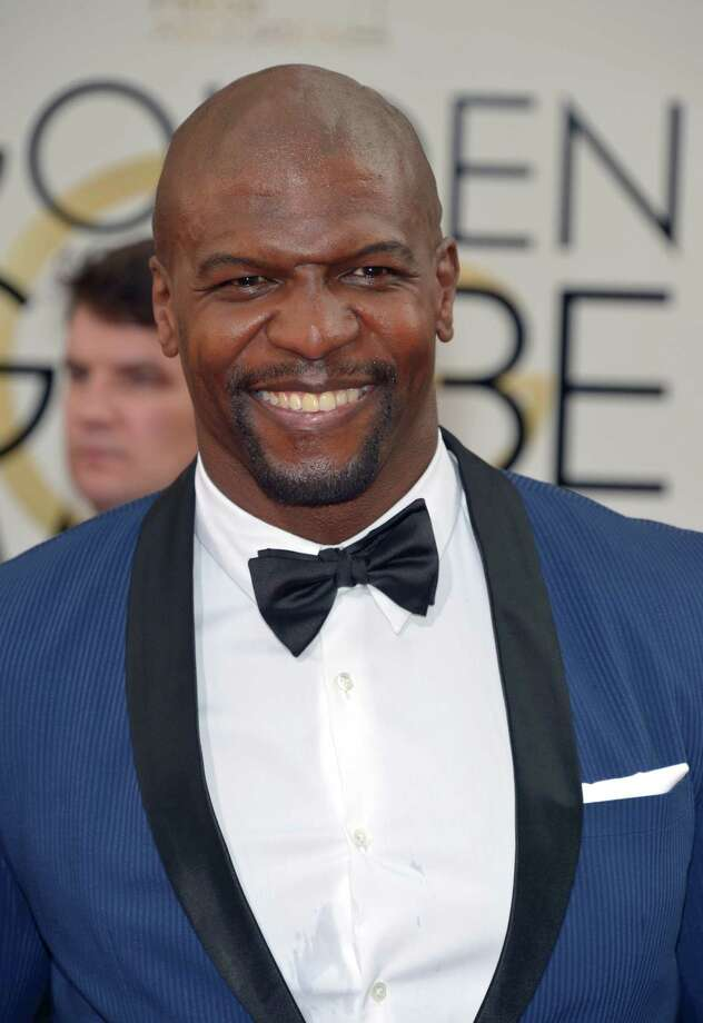 Terry Crews arrives at the 71st annual Golden Globe Awards at the Beverly Hilton Hotel on Sunday, Jan. 12, 2014, in Beverly Hills, Calif. (Photo by John Shearer/Invision/AP) ORG XMIT: CABR173 Photo: John Shearer / Invision