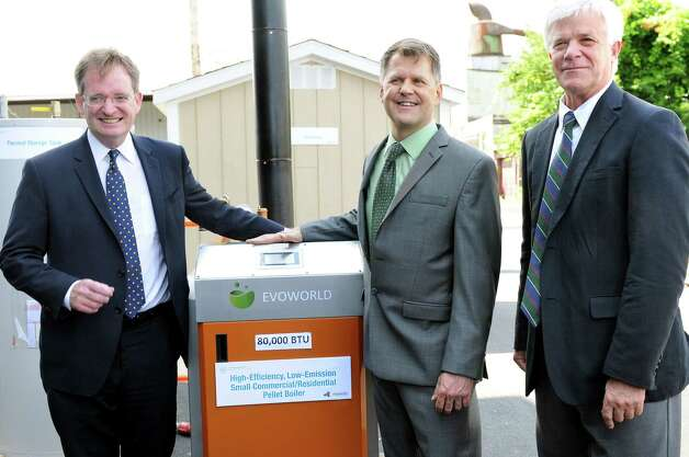 Lou Okonski, CEO of Evoworld Inc and Troy Boilerworks, center, poses with John Rhodes, president and CEO of NYSERDA, left, and Joe Martens, DEC commissioner, with a pellet boiler on Tuesday, July 29, 2014, at Evoworld Inc. in Troy, N.Y. NYSERDA and the DEC announced a roll-out of a comprehensive set of programs under Gov. Andrew Cuomo's Renewable Heat NY initiative. (Cindy Schultz / Times Union) Photo: Cindy Schultz / 00027962A