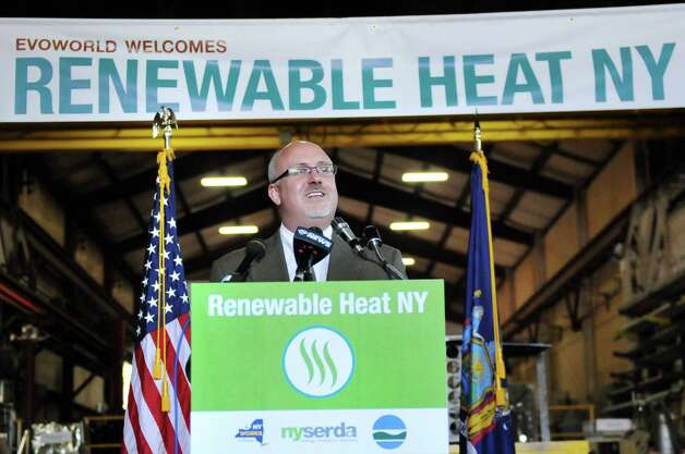 Mark Odell, Econoburn vice president of sales and marketing, speaks during a news conference on Tuesday, July 29, 2014, at Evoworld Inc. in Troy, N.Y. NYSERDA and the DEC announced a roll-out of a comprehensive set of programs under Gov. Andrew Cuomo's Renewable Heat NY initiative. (Cindy Schultz / Times Union) Photo: Cindy Schultz / 00027962A