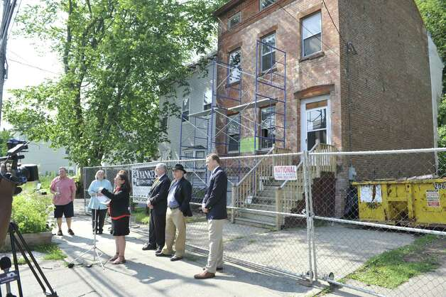 Susan Holland, executive director of The Historic Albany Foundation, addresses those gathered for a press conference out in front of the Stephen and Harriet Myers home at 194 Livingston Avenue on Tuesday, July 29, 2014, in Albany, N.Y.  The press event was held for members of the foundation to talk about a project where they have compiled a list of oldest buildings in the city.    (Paul Buckowski / Times Union) Photo: Paul Buckowski / 00027974A