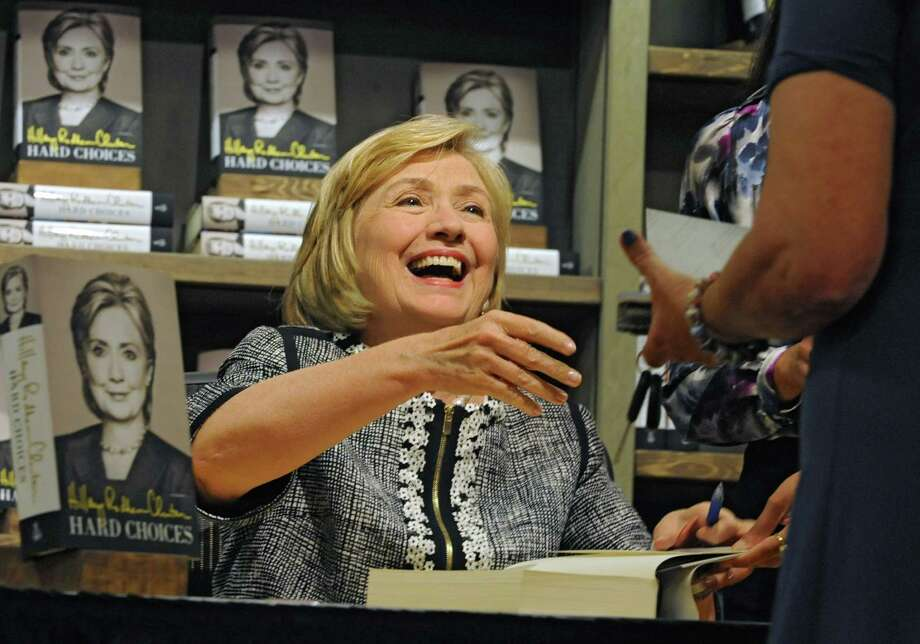 "Former Secretary of State, Senator and First Lady Hillary Rodham Clinton signs her new book ""Hard Choices"" at Northshire Bookstore July 29, 2014 in Saratoga Springs, N.Y.  (Lori Van Buren / Times Union) Photo: Lori Van Buren / 00027792A"